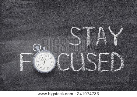 Stay Focused Phrase Handwritten On Chalkboard With Vintage Precise Stopwatch Used Instead Of O