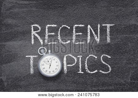 Recent Topics Phrase Handwritten On Chalkboard With Vintage Precise Stopwatch Used Instead Of O