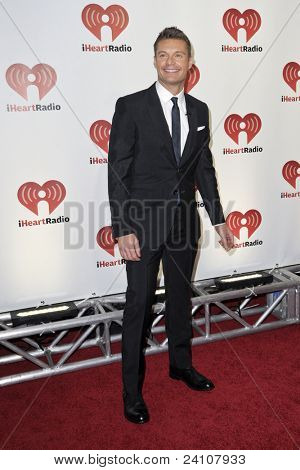 LAS VEGAS - SEPTEMBER 23 - Ryan Seacrest appears on the red carpet at the 2011 iHeartRadio Music Festival on September 23, 2011 at the MGM Grand Garden Arena in Las Vegas, Nevada.