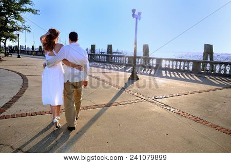 Engaged Couple Walking On Boardwalk Next To The Ocean, Fort Myers, Florida