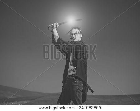 Martial Arts Concept. Man With Katana Sword Standing On Blue Sky. Concentration And Zen. Warrior Wit