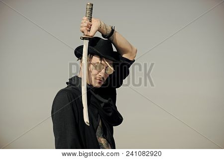 Samurai With Japan Katana Weapon Outdoors. Martial Arts Concept. Defense, Power, Honor, Force. Man H