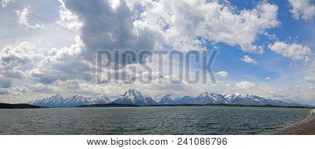 Panorama Of Mount Moran And Grand Teton Mountain Summit Peaks Under Cumulus Clouds At Jackson Lake I