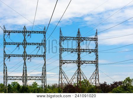 Two Large Rectangular High-voltage Electrical Transmission Towers With Power Lines And Insulators Ab