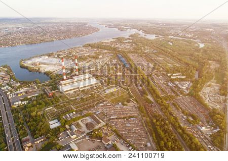 Industrial city. Industrial zone of the city of Kiev, Ukraine. European city on the river, power station in the city. Aerial view