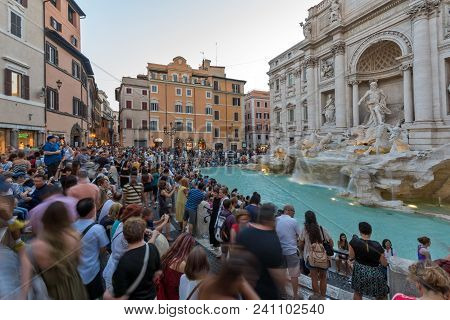 Rome, Italy - June 24, 2017: Sunset View Of Tourist Visiting Trevi Fountain (fontana Di Trevi) In Ci