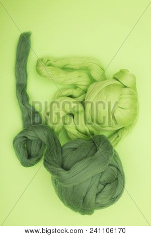 Two Hank merino wool green on a white background poster
