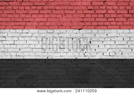 Yemen Flag Is Painted Onto An Old Brick Wall