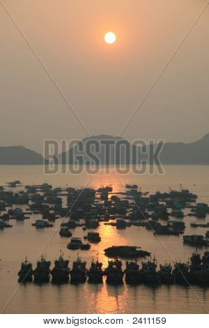 Sunset over the harbour of Cat Ba island in Halong Bay in Vietnam poster