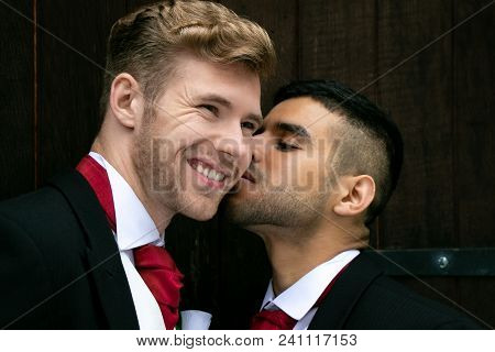 Gay Wedding, Grooms, Husbands Stop For Photo Opporutnity, Holding Hands, Cuddling And Kissing Outsid