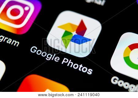 Sankt-petersburg, Russia, May 10, 2018: Google Photos Plus Application Icon On Apple Iphone X Screen