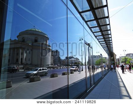 Reflection Of A Historical Architecture Building In A Modern Contemporary Building