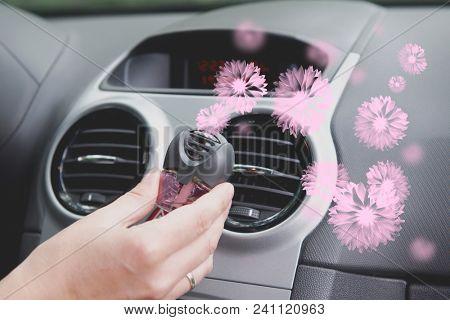 Car air freshner mounted to ventilation panel, fresh flower scent