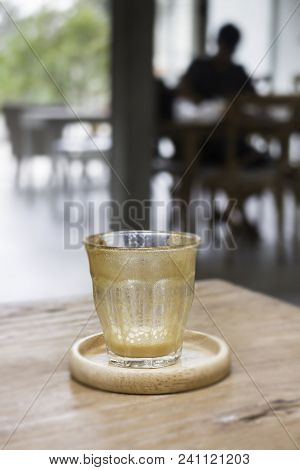 Finished Drink Of Latte Coffee On Wooden Saucer, Stock Photo
