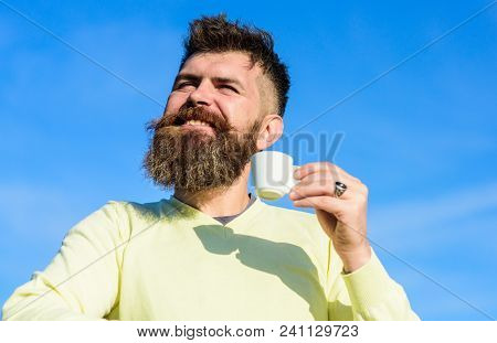 Man With Long Beard Enjoy Coffee. Man With Beard And Mustache On Smiling Face Drinks Coffee, Blue Sk