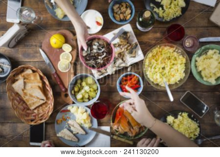 Background Blur. Background Blurred Image Of Dinner Table With Different Food. Easter, Christmas, Bi