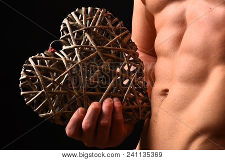 Guys Abs And Strong Chest. Athletes Body In Close Up, Hand Holding Big Rattan Heart. Male With Naked