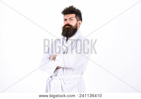 Handsome Man In A Bathrobe Isolated On White Background. Bearded Guy With Stylish Mustache Standing