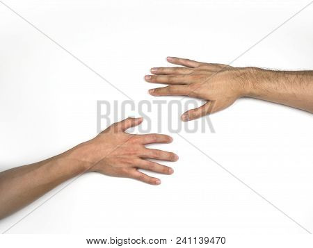 Hands Reaching To Each Other On The Floor