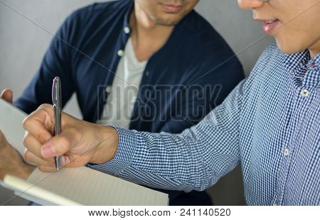 Two Men Studying Close Up, Looking At Other Note