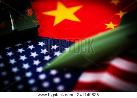 China-US trade war concept - Military facilities on the flag of China and the United States, tank, rocket, guns poster