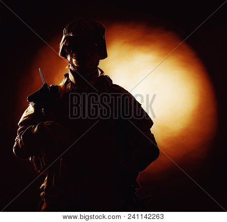 Silhouette Photo Of Army Soldier, Modern Combatant, Military Conflict Participant Standing In Combat