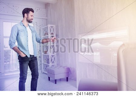 Emotional Programmer. Positive Enthusiastic Programmer Standing In Front Of A Transparent Screen And