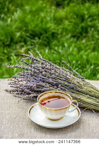 Cup Of Tea And Lavender On The Table. Tea With Lavender In The Garden. Summer Tea. Cup Of Tea On Gre
