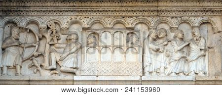 MODENA, ITALY - JUNE 04: Plate with stories from Genesis: Killing of Cain and the Ark of Noah, bass-relief by Wiligelmo, Modena Cathedral, Italy on June 04, 2017.