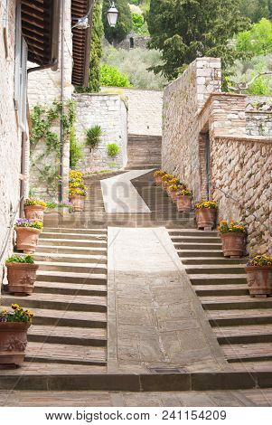 Uphill Steps With Flower Pots Along A Path In A Street Of Gubbio City
