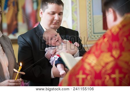 Belarus, Gomel, May 6, 2018. Church Of Volotovo. Baptism Of A Newborn Child.the Godfather Holds A Jo
