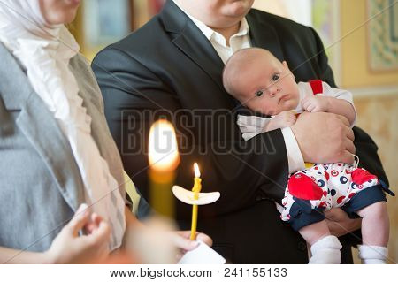 Belarus, Gomel, May 6, 2018. Church Of Volotovo. Baptism Of A Newborn Child.the Newborn In The Arms