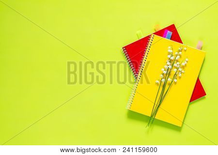 Many Blossom Flower Lily Of The Valley And Red And Yellow Notebooks With Bouquet, Green Juicy Apples