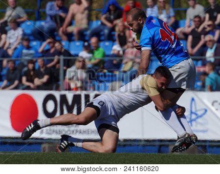 ST. PETERSBURG, RUSSIA - MAY 12, 2018: Match RC Kuban, Russia vs RC Academy, Georgia (blue uniform) during Rugby Europe Sevens Club Champion's Trophy. Kuban won 29-0