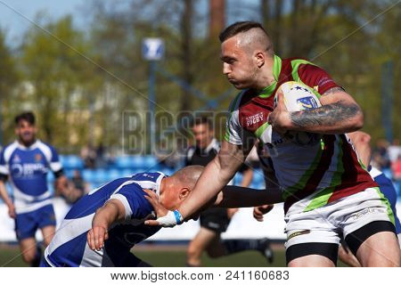 ST. PETERSBURG, RUSSIA - MAY 12, 2018: Match RC Baltrex, Lithuania vs Helsinki Rugby Club, Finland (blue uniform) during Rugby Europe Sevens Club Champion's Trophy. Baltrex won 38-0