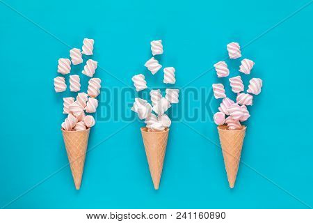 Three Waffle Cone With Marshmallow Bouquets On Blue Surface. Flat Lay, Top View Sweet Food Backgroun