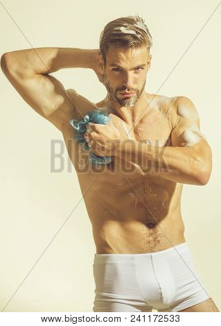 Nude Sexy Man In Boxer Shorts Washing Upper Body In Bathroom. Sexy Man Is Washing Body With Sponge,