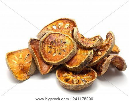 Dried Herbs And Dried Bael Fruit , Bael Dry , On White Background.