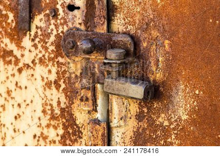 Rusty Old Castle On The Iron Doors. Country Style. Close-up. Iron Texture