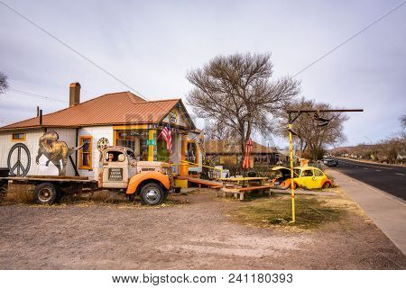 Seligman, Arizona, Usa - January 2, 2018 : Old Cars Left Abandoned In Front Of A Souvenir Shop On Hi