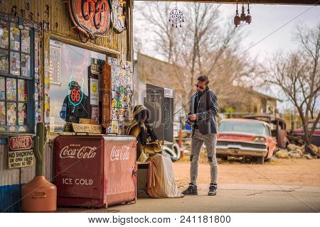 Hackberry, Arizona, Usa - January 2, 2018 : Young Man Uses A Telephone At A Vintage Gas Station On H