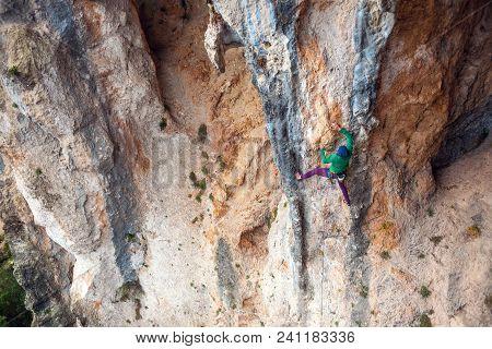A Woman Climbs The Rock.