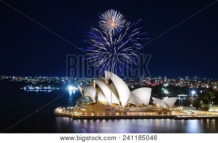 Sydney, Australia - March 8, 2018 - Blue And White Fireworks Explode In The Sky Over The Sydney Oper