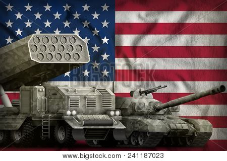 Tank And Rocket Artillery With City Camouflage On The Usa Flag Background. Usa Heavy Military Armore
