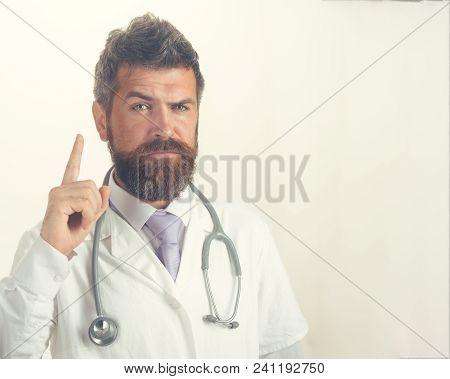 Doctor Warns Of Danger, Picked His Finger Up. Healthcare, Medicine, Profession And Warning Gesture C