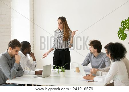 Angry Caucasian Female Executive Or Team Leader Firing Unprofessional African Male Employee For Bad