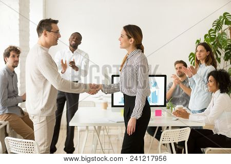 Smiling Female Boss Promoting Rewarding Handshaking Motivated Worker Showing Respect While Team Appl