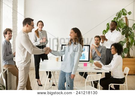 Boss Shaking Hand Of Young Shy Woman Congratulating Successful Employee With Promotion, Hiring Inter