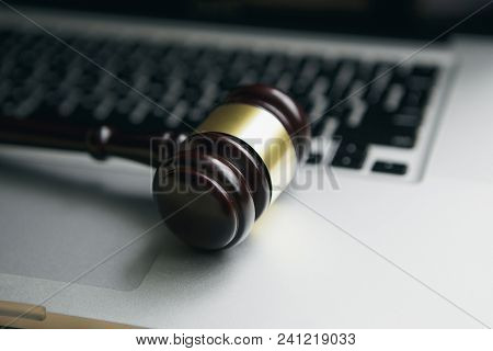 Wooden Judge Gavel On Keyboard Laptop Computer.concept Of Cyber Law Or Law About Computer.