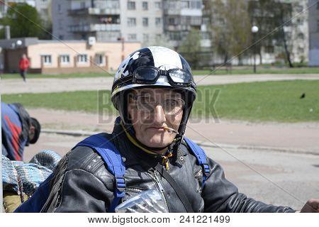 Ukraine,shostka - April 28,2018: Elderly Motorcyclist Wearing In Leather Jacket, Glasses And Helmet